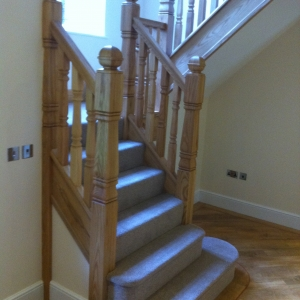 Ash carpet grade, with ash provincial spindles and newels