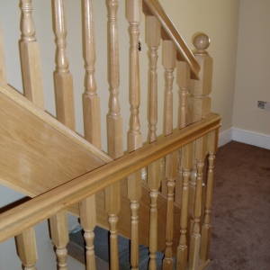 Solid Oak, with oxford fluted spindle